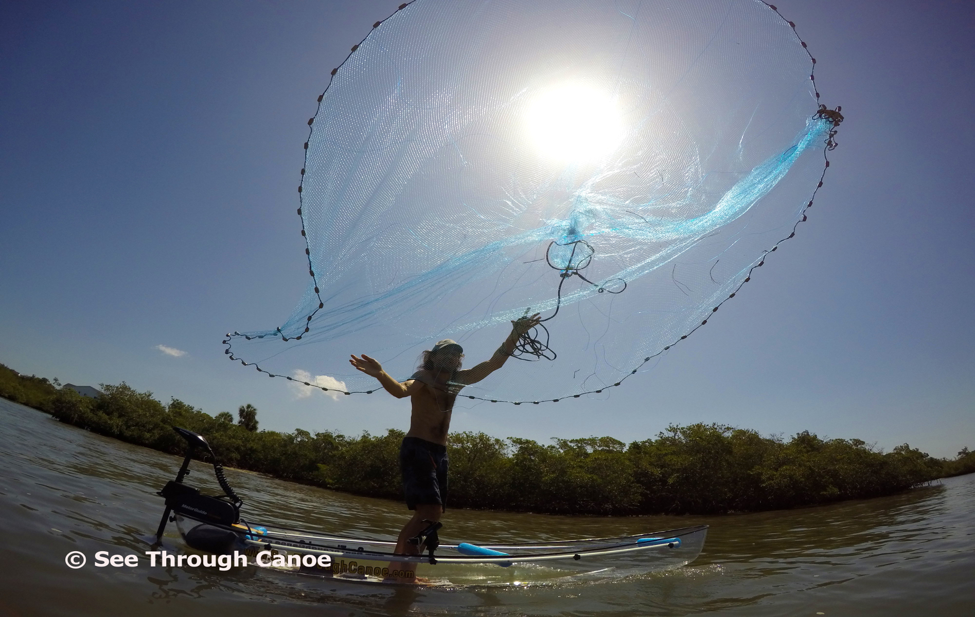 Throwing a cast net from the clear canoe