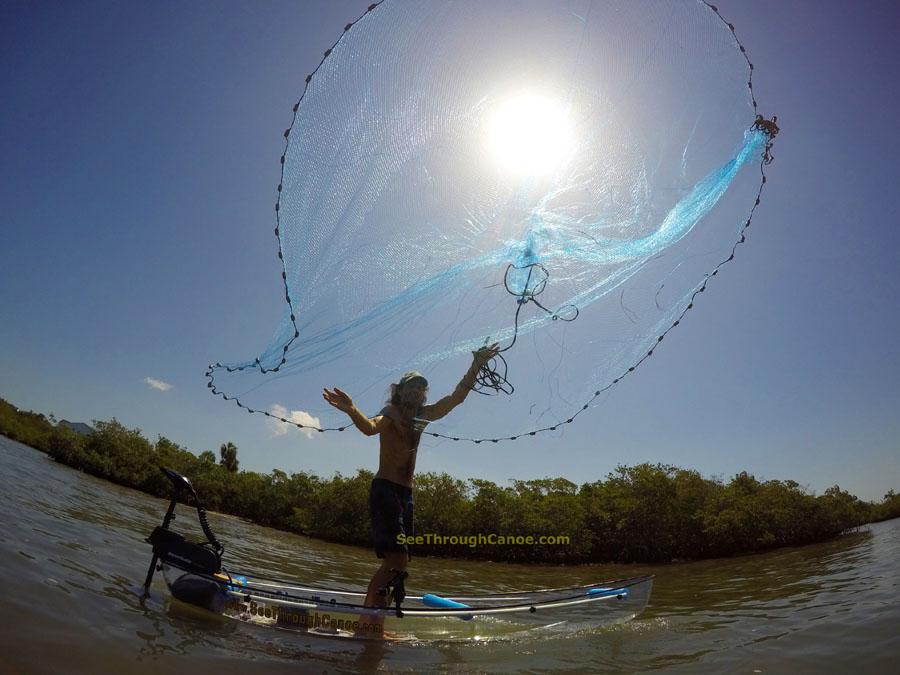 Cast net thrown from a canoe