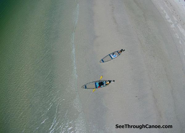 Clear Kayaks on the beach.