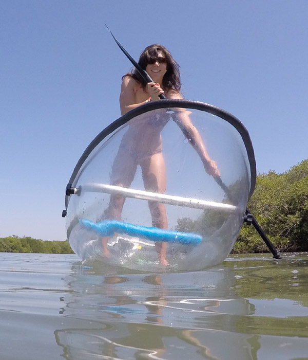 Standing in a clear kayak