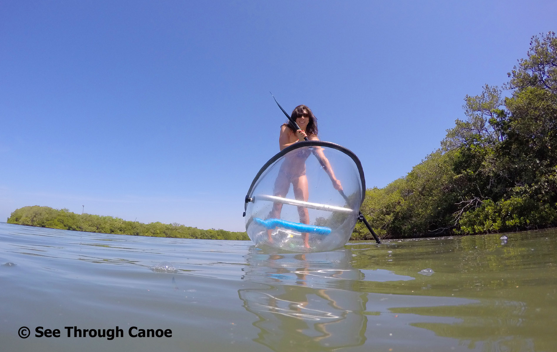 Stand up paddling in the clear kayak